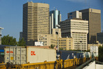 a train carrying shipping containers passes through downtown Winnipeg, Manitoba, Canada