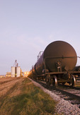 rail tanker cars at a canola crushing plant, St. Agathe, Manitoba, Canada