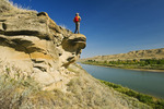 Hiker along the South Saskatchewan River near Sandy Point Park north of Medicine Hat, Alberta, Canada.