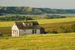 abandoned farm house and farmland in the Qu'Appelle Valley, Saskatchewan, Canada