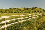 fence with eroded hills in the background,  Qu´Appelle  River Valley,  Saskatchewan, Canada