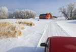 truck along country lane with red barn in background, winter, near Oakbank,  Manitoba, Canada