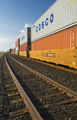 moving rail cars carrying containers near Winnipeg, Manitoba, Canada