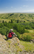 hiker at the Conglomerate Cliffs lookout,Cypress Hills Interprovincial Park, Saskatchewan, Canada
