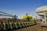 farmer loading seed tank with soybean seed during spring planting near Lorette, Manitoba, Canada