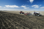 moving tractor and and air till seeder planting wheat, near Dugald, Manitoba, Canada