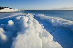 washed up ice flows along Lake Winnipeg, Manitoba, Canada