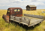 old truck and grain bin near Onefour, Alberta, Canada