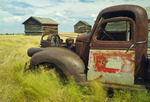 old truck and grain bins near Onefour, Alberta, Canada