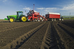 a potatoe planter being loaded with seed potatoes, near Cypress River, Manitoba, Canada