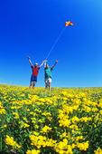 girls flying a kite in trefoil field
