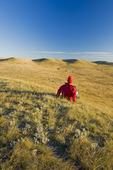 a man looks out over the East Block, Grasslands National Park, Saskatchewan, Canada