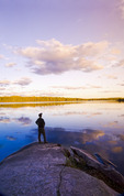 a man looks out over Bunny Lake, near Sioux Narrows, Northwestern Ontario, Canada