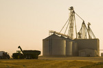 a grain wagon loaded with spring wheat harvest in front of storage facility, near Somerset, Manitoba, Canada