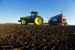 tractor pulling potato planter, near Somerset, Manitoba, Canada