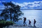 family hiking along Canadian Shield rock, Big Whitshell Lake, Whiteshell Provincial Park, Manitoba, Canada