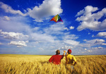 two children kite flying near Ponteix, Sask (MR)