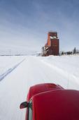 pick up truck on road, old grain elevator, Dysart, Saskatchewan, Canada