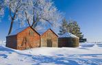 snow drifts, old grain bins, near Estevan, Saskatchewan, Canada