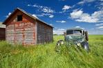 old farm truck beside grain bin, near Hazenmore, Saskatchewan, Canada