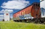 rail hopper car with graffiti, old grain elevator, Aneroid, Saskatchewan, Canada