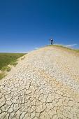hiker on top of 70 Mile Butte, West Block, Grasslands National Park, Saskatchewan, Canada