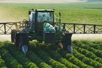 a high clearance sprayer applies fungicide on potatoes, near Holland, Manitoba, Canada