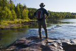 hiker along the Clearwater River, Clearwater River Provincial Park,  Saskatchewan, Canada
