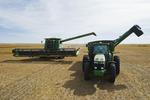 a combine prepares to unload into a grain wagon during the lentil harvest, near Congress,  Saskatchewan, Canada