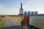 a truck leaves an inland grain terminal after hauling grain, Assiniboia, Saskatchewan, Canada