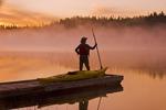 man on dock with kayak, Little Deer Lake, Lac La Ronge Provincial Park,  Saskatchewan, Canada