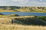 hiker, Saskatchewan Landing Provincial Park with Lake Diefenbaker in the background, ,  Saskatchewan, Canada