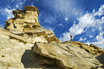 a hiker along looks out over a weathered landscape, Writing On Stone Provincial Park, Alberta, Canada