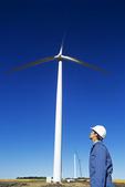 worker at wind turbine construction site, St. Leon, Manitoba, Canada