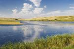 prairie landscape with slough in the foreground, near Elrose, Saskatchewan, Canada