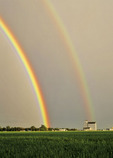 rainbow over grain elevator, Sanford, Manitoba, Canada
