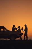 famer, wife  and son examine wheat near Treherne, Manitoba, Canada