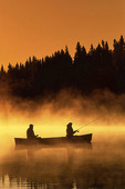 couple fishing from a canoe along the Whiteshell River in the early morning, Whiteshell Provincial Park, Manitoba, Canada