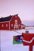 red barn with mailbox in front, near Oakbank, Manitoba, Canada
