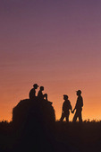 farm family,children on round alfalfa bale near Winnipeg, Manitoba, Canada