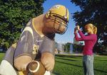 a girl takes a photo of Bears on Broadway,  Winnipeg, Manitoba