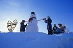 children making a snowman, Manitoba, Canada