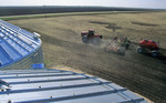 moving tractor and and air till seeder planting grain, near Dugald, Manitoba, Canada