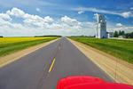 road going across the prairies, near Culross, Manitoba, Canada