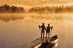 couple along Winnipeg River, Pinawa, Manitoba, Canada