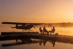 family on float plane dock, along Red River, Manitoba, Canada