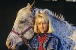 girl with horse near Richer, Manitoba, Canada
