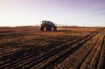 a high clearance sprayer applies liquid fertilizer on a newly seeded field, near Dugald, Manitoba, Canada