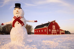 red barn with snowman, winter, near Oakbank, Manitoba, Canada