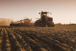 moving tractor and and air till seeder planting grain, Lorette, Manitoba, Canada